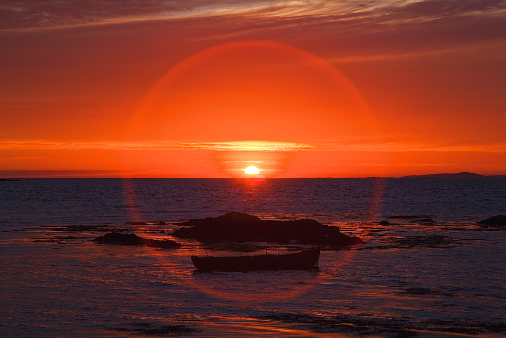 Sunset over mannin bay in a circular glare, County galway, ireland