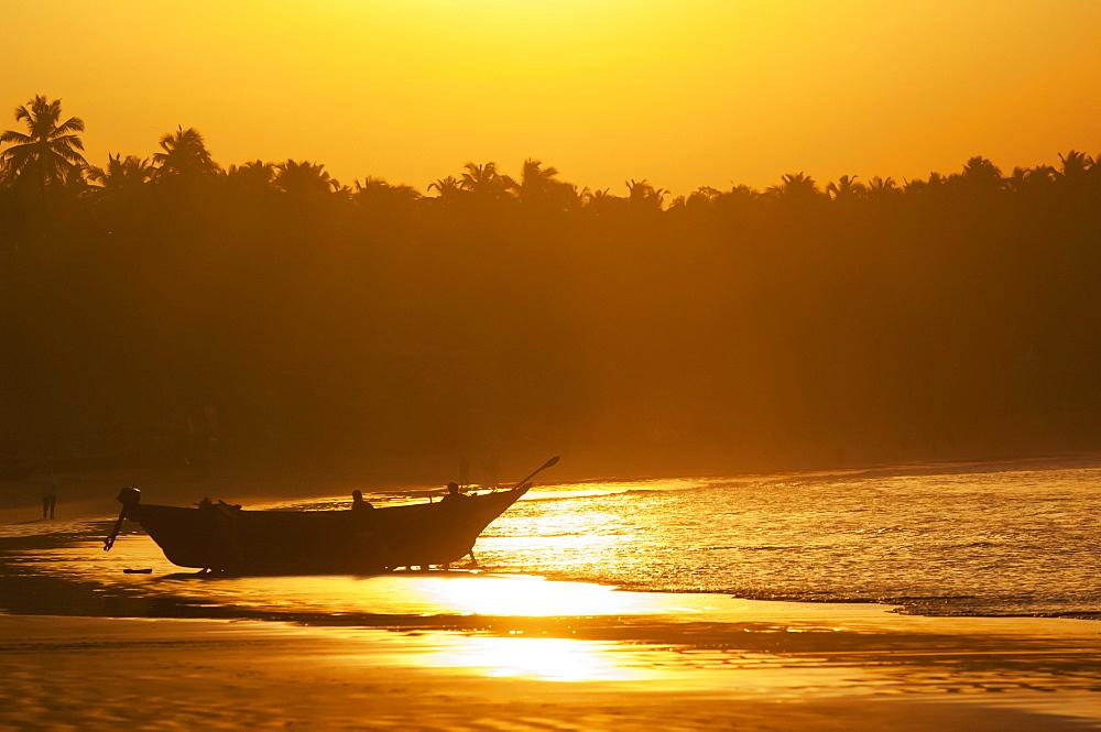 Fishing boat at sunset on palolem beach, Goa karnataka india
