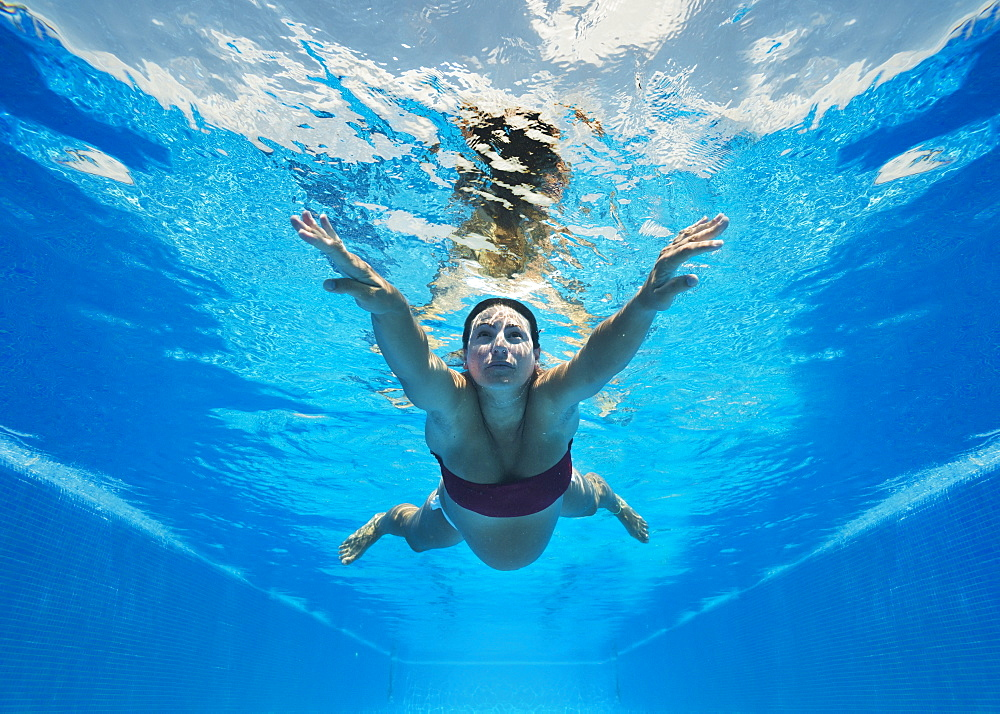 A pregnant woman swimming underwater, Tarifa cadiz andalusia spain