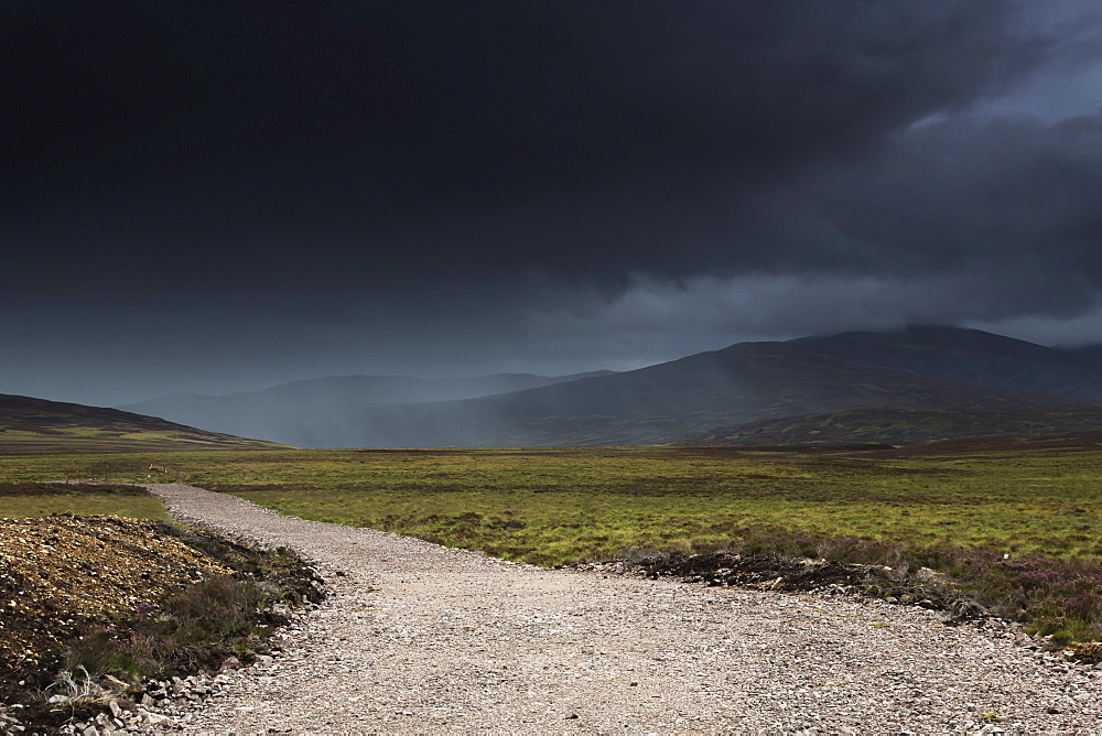 A gravel path under dark storm clouds, Highlands scotland