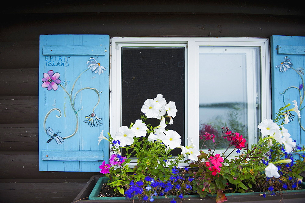 Cabin window with a window flower pot underneath, kenora ontario canada