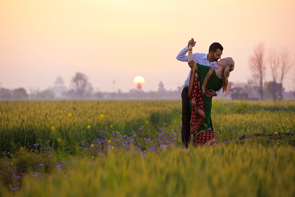 Portrait Of A Mixed Race Couple Her Wearing A Sari In A Field At Sunset, Ludhiana, Punjab, India - 1116-42007