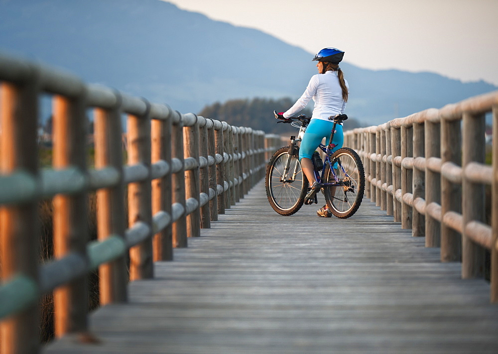 A Cyclist On A Wooden Boardwalk, Tarifa, Cadiz, Andalusia, Spain - 1116-42023