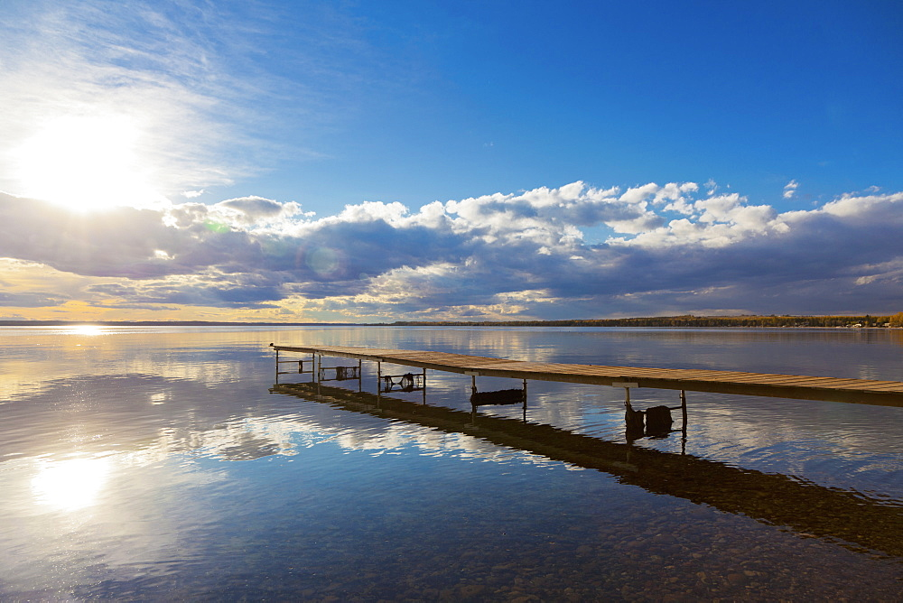 A Dock Leading Out Into The Lake At Sunrise, Pigeon Lake, Alberta, Canada - 1116-42035