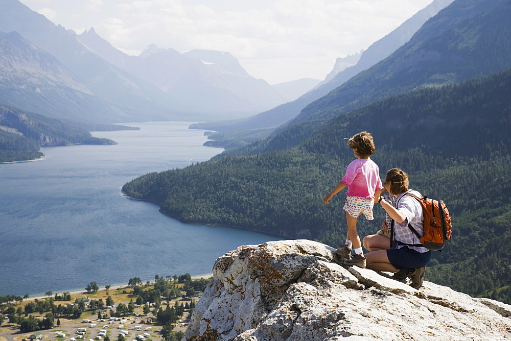 Mother And Daughter Enjoy View At Waterton Lakes National Park, Alberta Canada