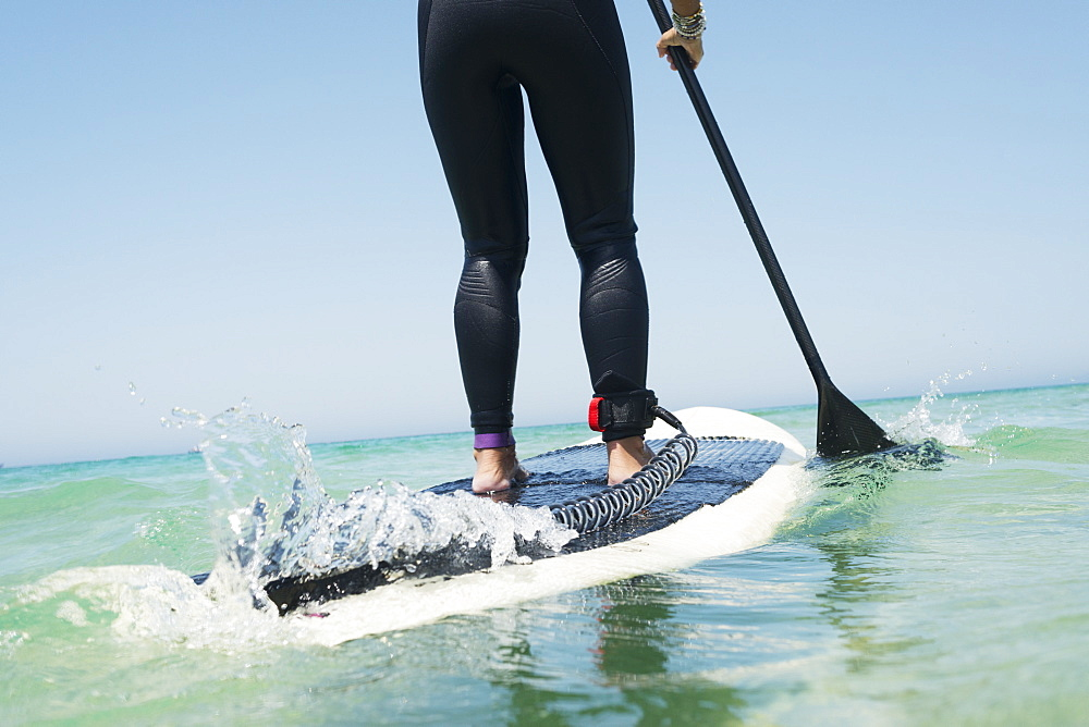 Paddling on a surfboard, Tarifa cadiz andalusia spain - 1116-42092