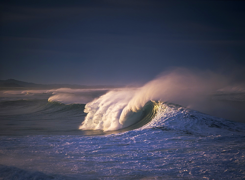 A Wave Breaks At Ziolkouski Beach, Winchester Bay, Oregon, United States Of America