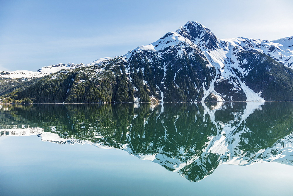 The Snow Covered Chugach Mountains Reflected In The Waters Of Barry Arm In Springtime, Chugach National Forest, Alaska, United States Of America