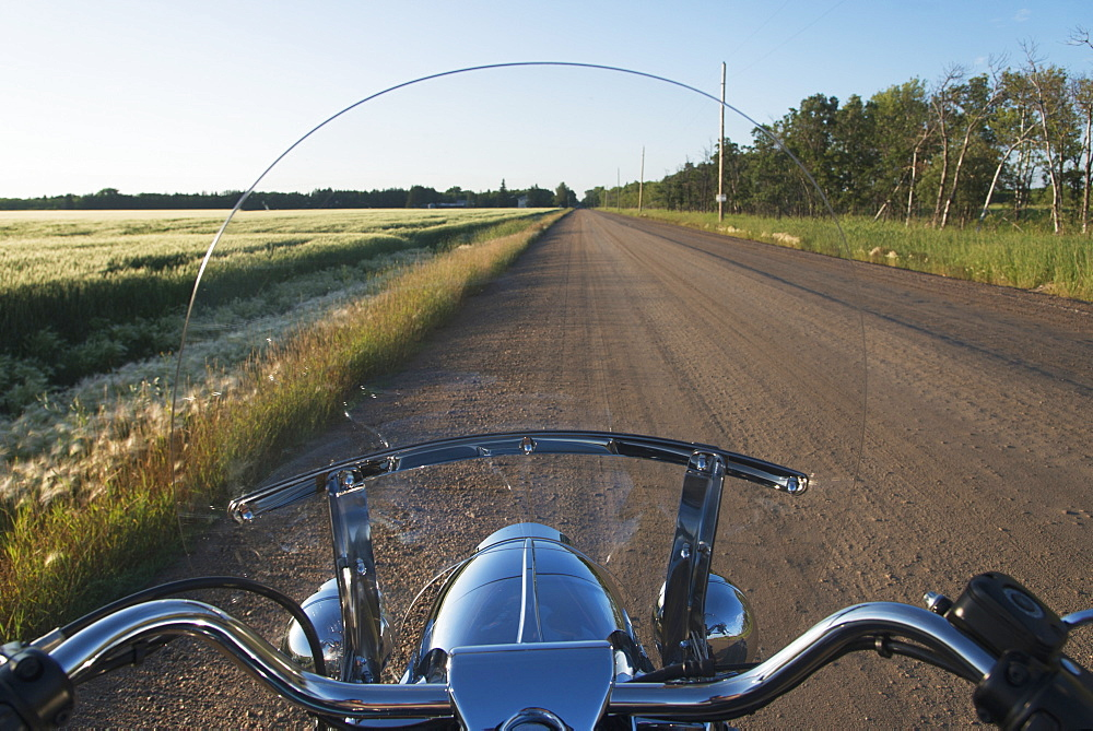 View Of A Dirt Road Through A Motorcycle Windshield, Winnipeg, Manitoba, Canada