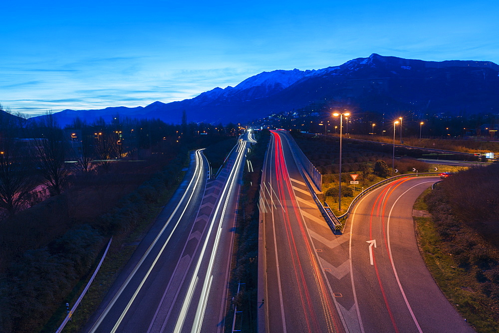 Light Trails Of Vehicle Lights On A Road At Dusk, Locarno, Ticino, Switzerland