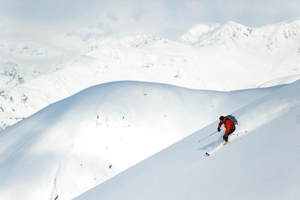 Man Skiing The West Face Of Peak 3720, Turnagain Arm, Chugach Mountains, Southcentral Alaska