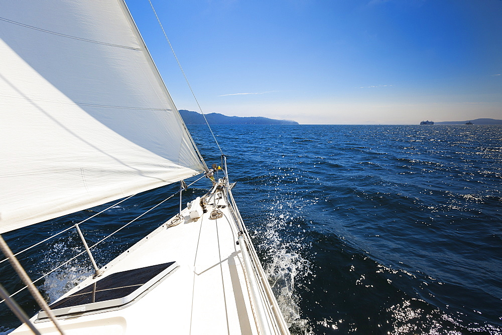A Sailboat Sails In The Gulf Islands On A Sunny Day, British Columbia, Canada