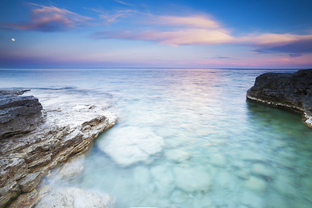 Seeing Into The Clear Rocky Water At Sunset At Cave Point In Sturgeon Bay, Wisconsin, United States Of America