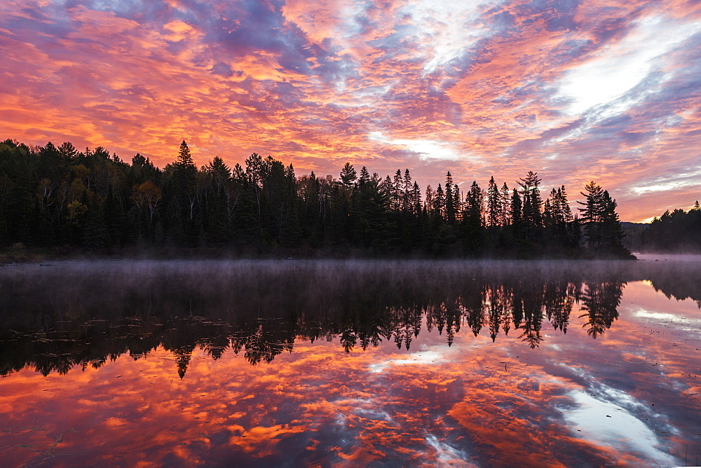 Red Clouds Light The Sky And Water Of Costello Lake, Algonquin Park, Ontario, Canada