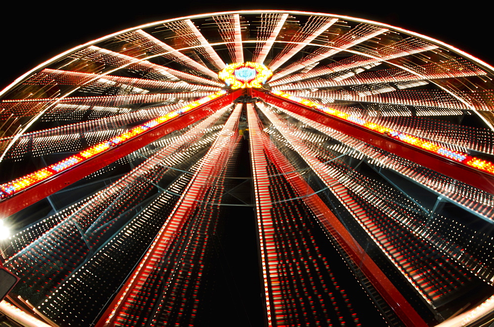 Ferris Wheel Glowing And Spinning At Nighttime, Locarno, Ticino, Switzerland