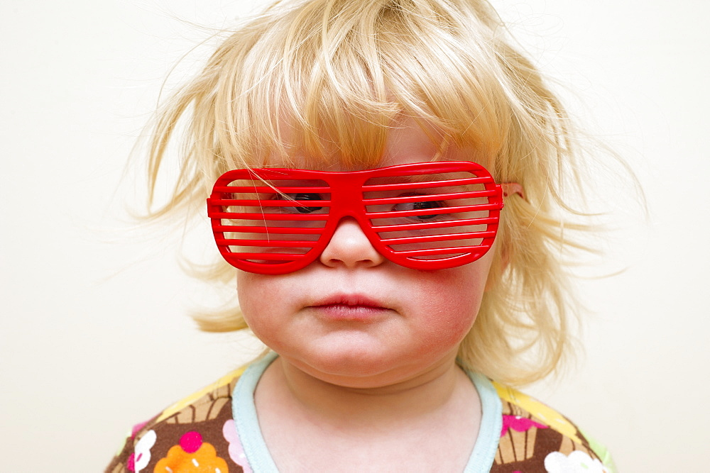 A Young Girl With Funny Red Eyeglasses, Alberta, Canada - 1116-42458