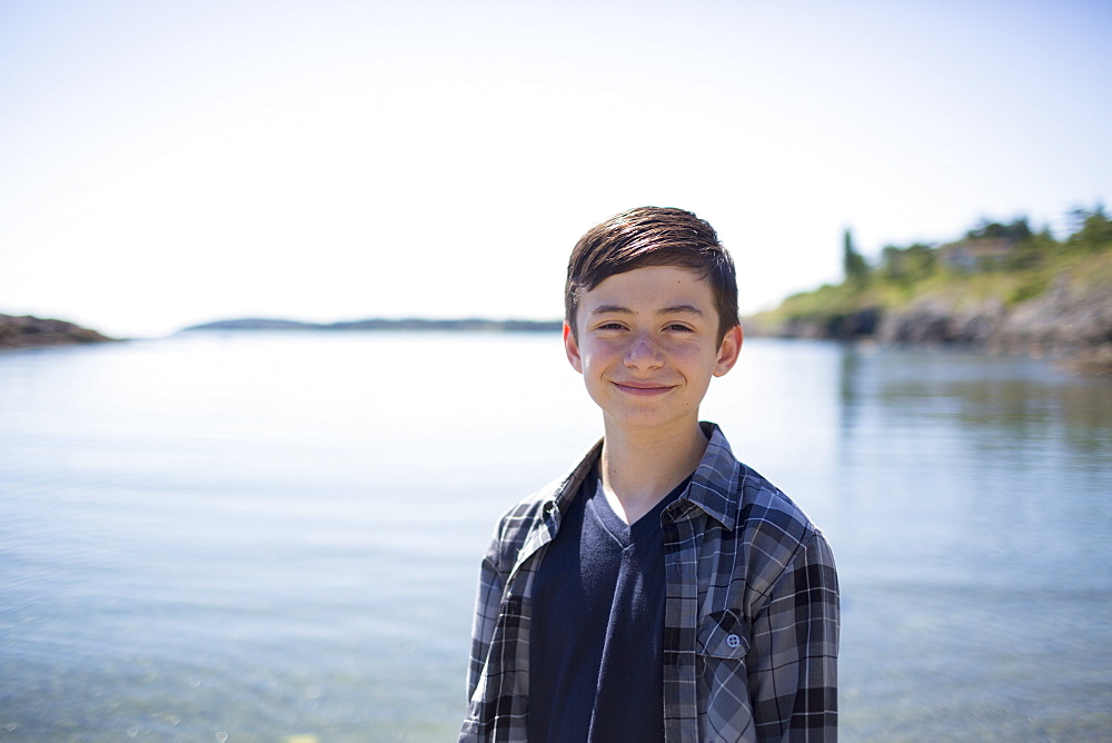 Portrait Of A Boy With The Water And Coastline In The Background, Victoria, British Columbia, Canada