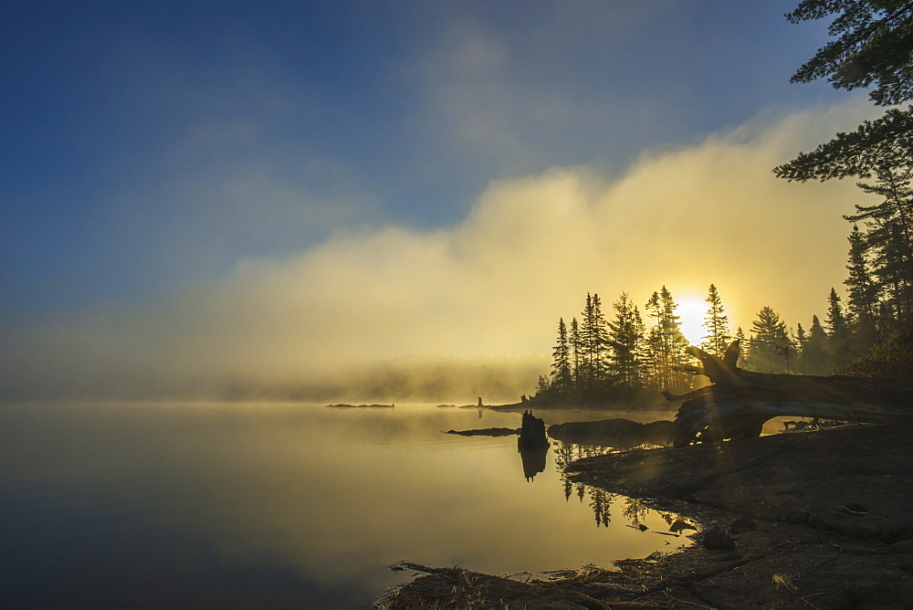 Fog Over A Lake At Sunrise, Quebec, Canada
