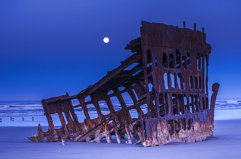 The Moon Sets Over The Wreck Of The Peter Iredale, Oregon, United States Of America