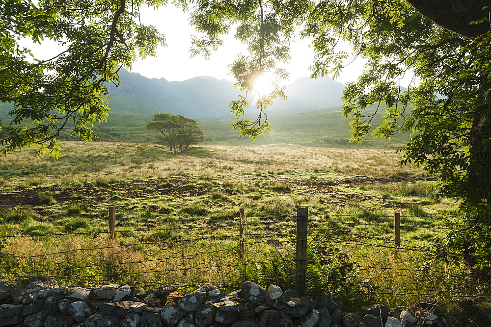 Looking Across A Field At Dawn With The Ridge Of The Black Cuillin Behind, Glen Brittle, Isle Of Skye, Scotland