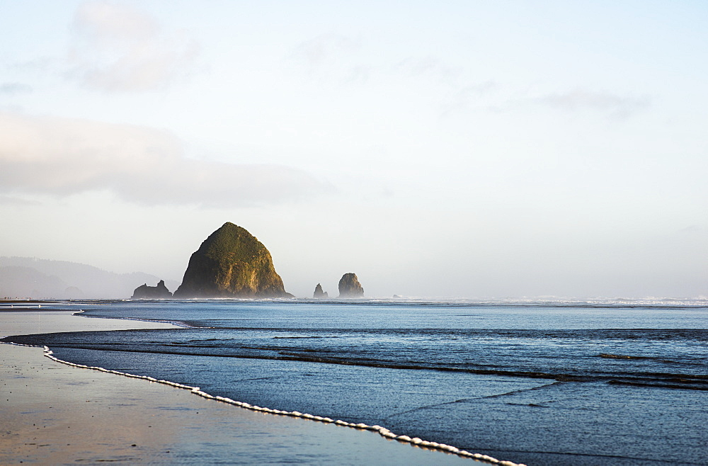 Haystack Rock At Cannon Beach, A Famous Landmark, Cannon Beach, Oregon, United States Of America
