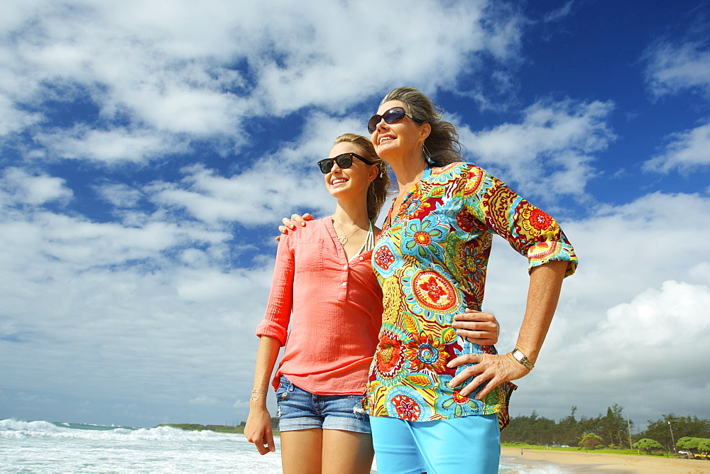 A Mother And Daughter Together On The Beach, Kauai, Hawaii, United States Of America