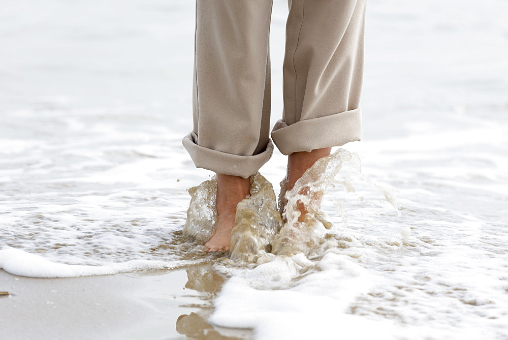 Walking Barefoot Along The Beach With Water Washing Over Feet, Rimini, Emilia-Romagna, Italy