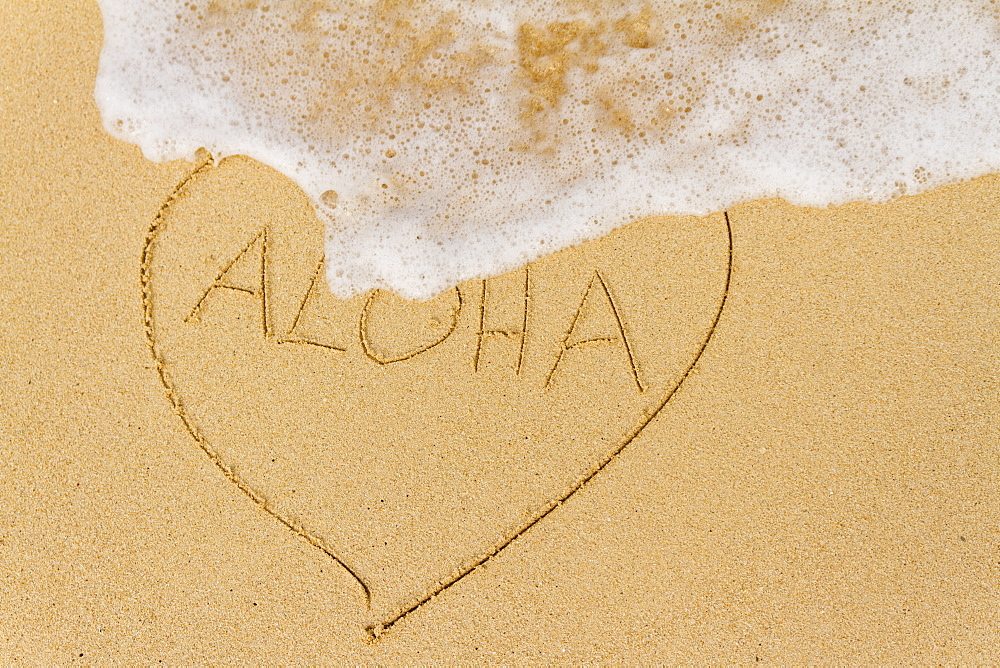 Ocean Water Washing Over A Heart Drawn In The Sand With The Word Aloha, Honolulu, Oahu, Hawaii, United States Of America
