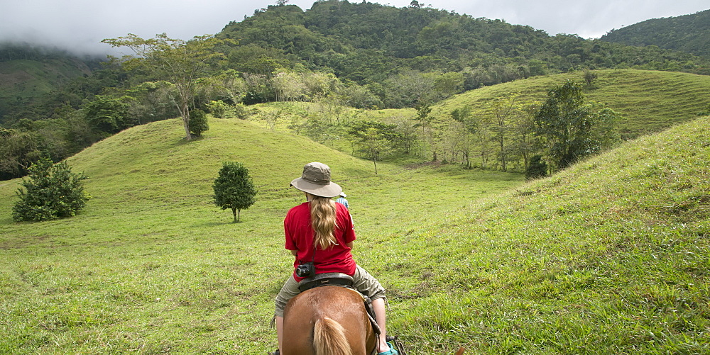 A Girl Riding Horseback Through The Hills, Zacapa, Guatemala
