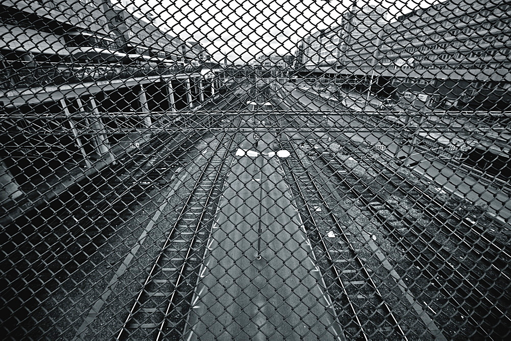 Train Tracks Seen Through Chain Link Fence, Stockholm, Sweden
