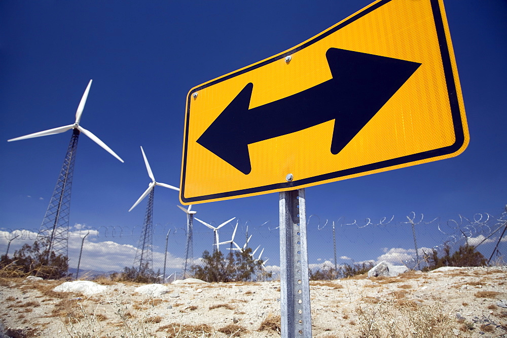 Wind Turbines And Road Sign, Palm Springs, California, United States Of America