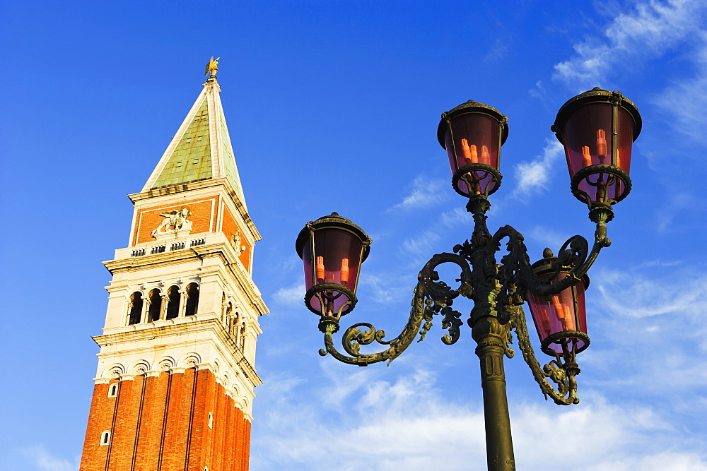 A Tower And Lamp Post In Piazza San Marco, Venice, Italy