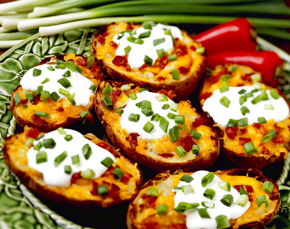 Food - Twice-baked Potatoes with Bacon, garnished with chopped green onions (scallions), enchilada sauce and red chili peppers. - 1116-42782