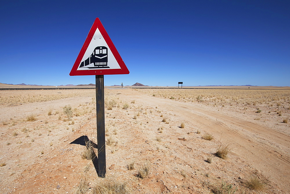 Railway traffic sign beside a desert road, Garub namibia