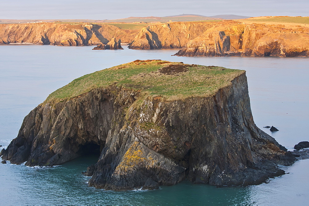 Small Island And Cliffs At Sundown Near Trefin Village On The Pembrokeshire Coast Path, Wales