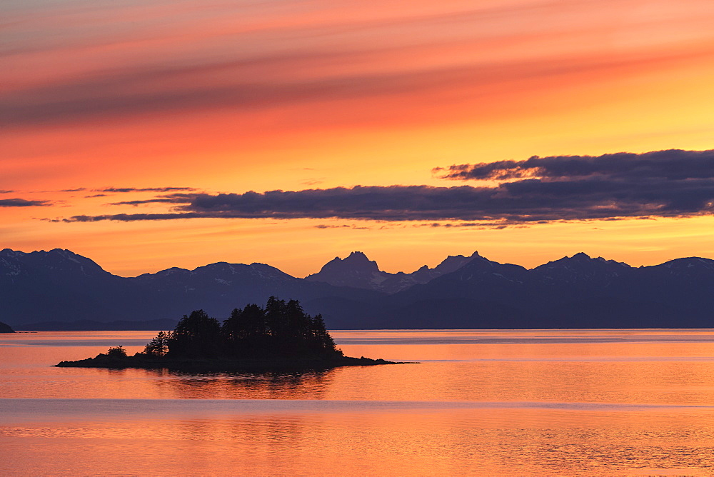 A Summer Sunset Colours The Sky Adjacent To Lynn Canal, With Chilkat Mountains In The Distance, Alaska, United States Of America
