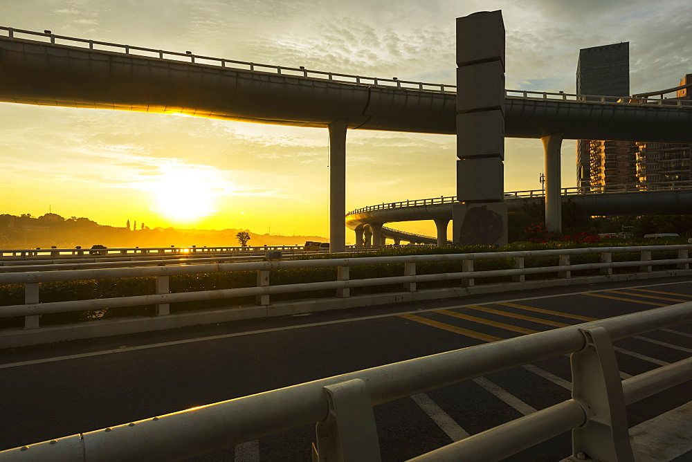 Highway From Xiamen City, China At Sunset, With Gulangyu Island In The Background, Xiamen, China