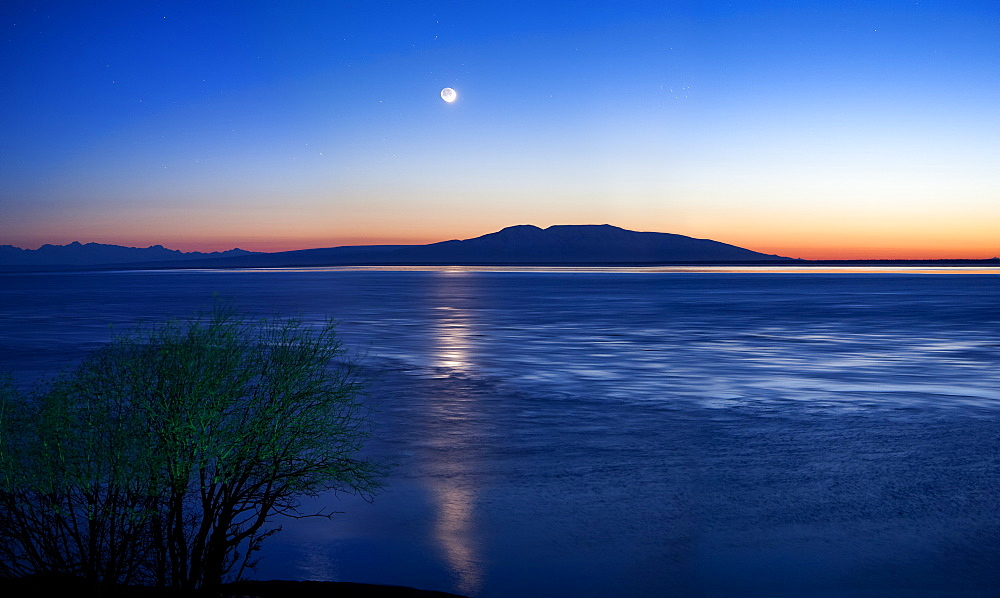 Moon Setting Over Mt. Susitna, Also Known As Sleeping Lady, West Of Anchorage, Alaska, United States Of America