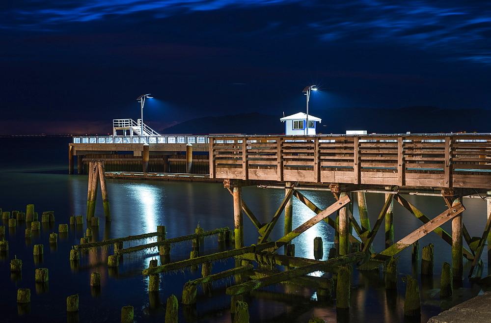 17th Street Pier Is Illuminated On A Summer Evening, Astoria, Oregon, United States Of America