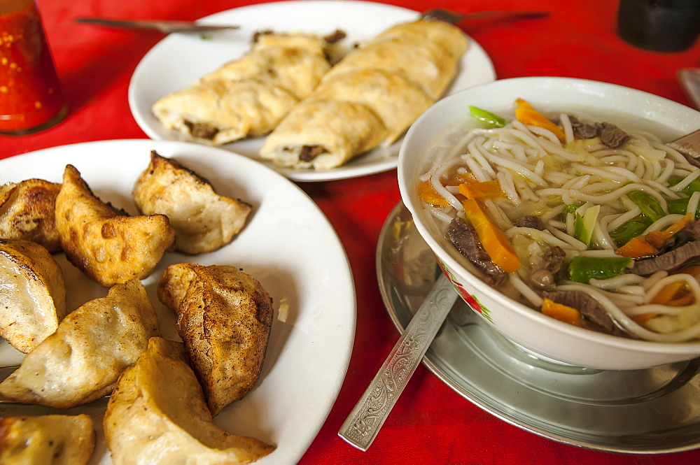 Special Tibetan Momos, Spring Rolls And Noodles In A Tibetan Restaurant, Pokhara, Nepal