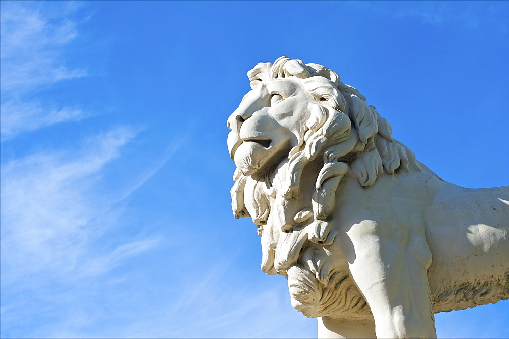 Statue Of A Lion Against A Blue Sky, Trafalgar Square, London, England