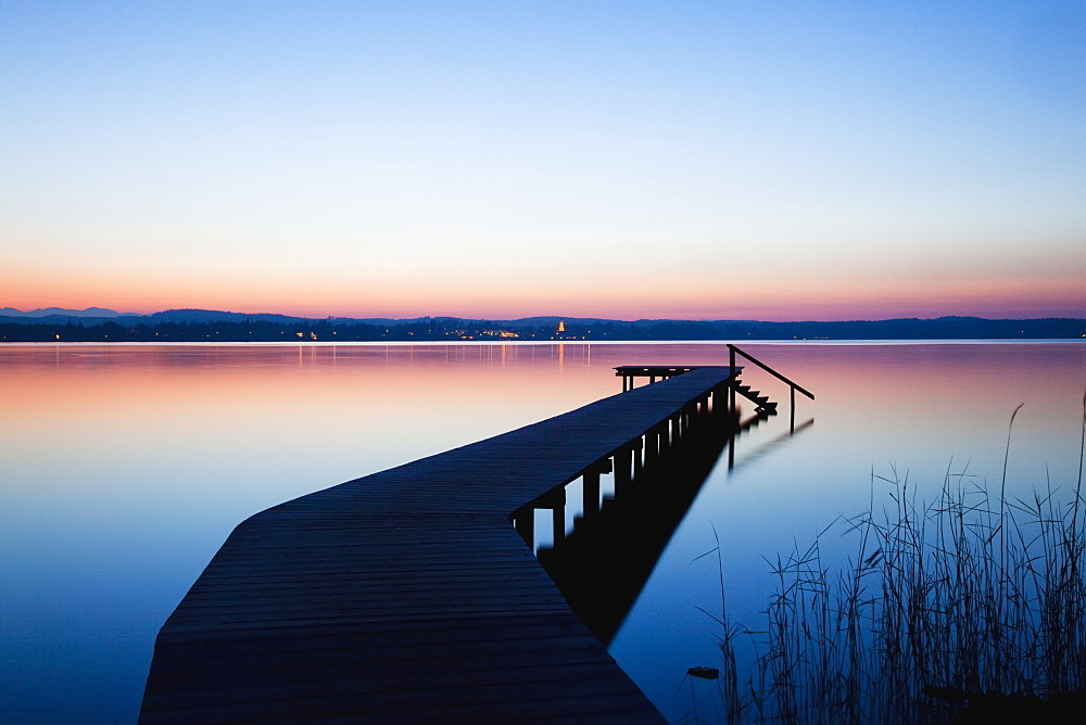 A Wooden Dock Leading Out To A Tranquil Lake At Sunset, Starnberger See, Bavaria, Germany