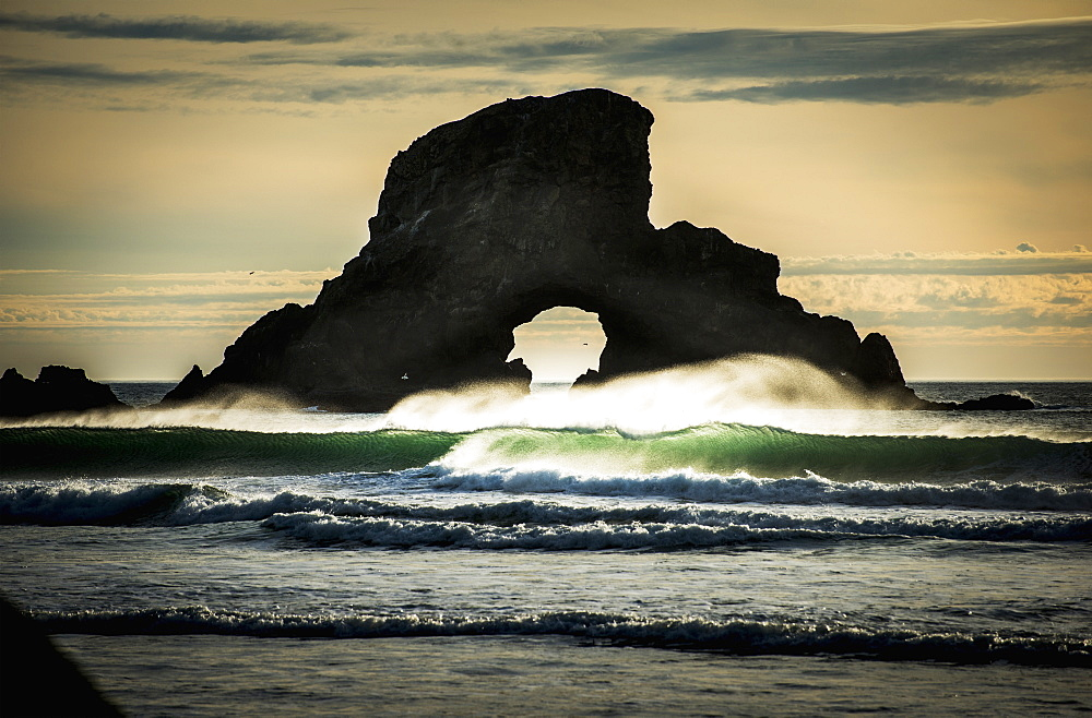 Surf Breaks Near A Natural Arch, Cannon Beach, Oregon, United States Of America