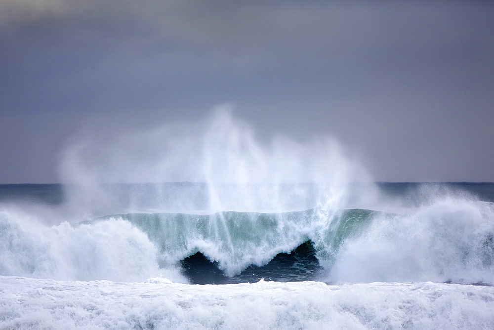 Dramatic Ocean Wave Off The Coast Of Southern Iceland Near The Blue Lagoon, Grindavik, Iceland