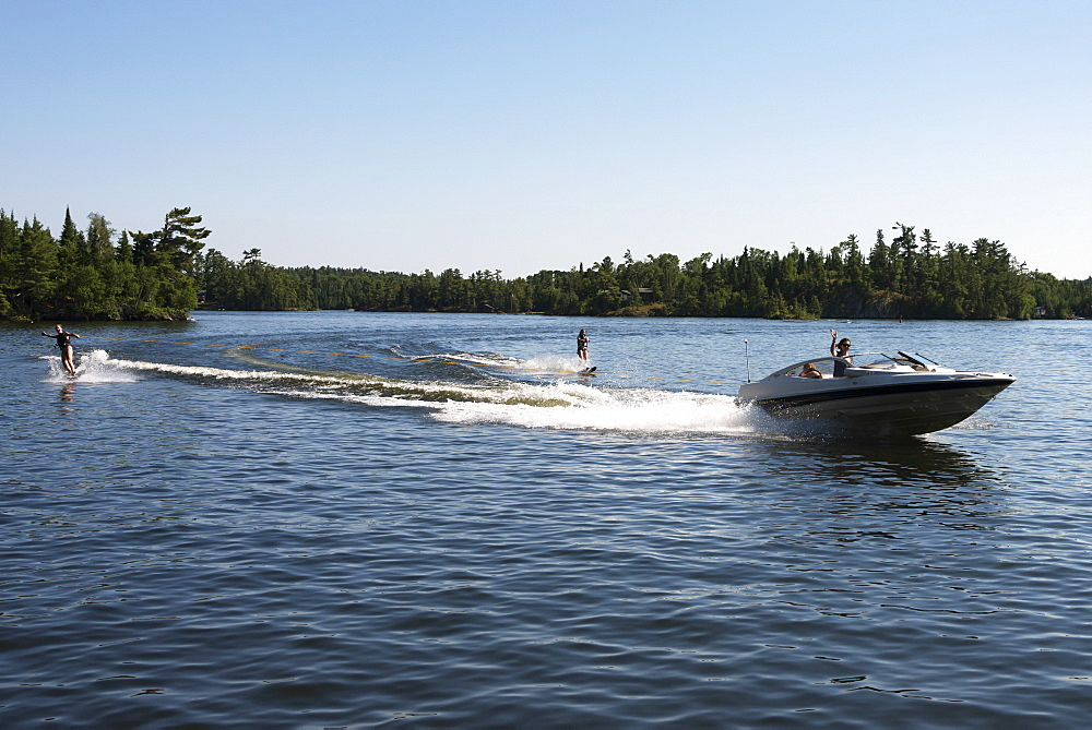 A Boat Pulling Two Waterskiiers, Ontario, Canada