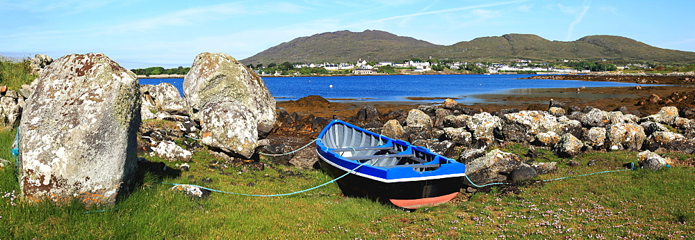 A Boat Tethered On Shore And A View Of Roundstone From Inishnee Island, County Galway, Ireland