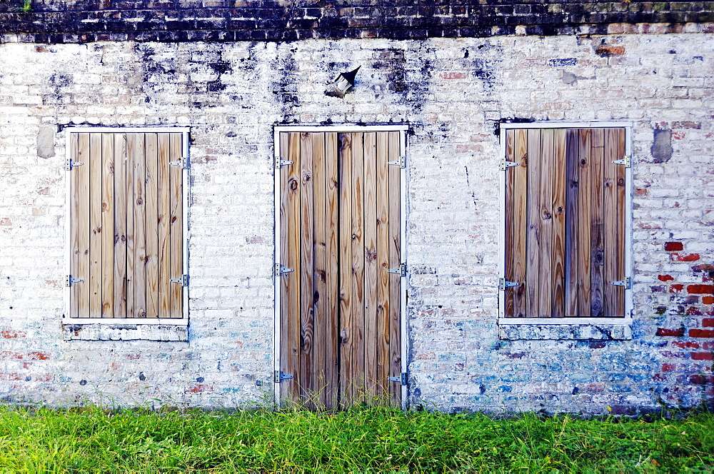 Louisiana, New Oreleans, Abandoned Brick Building With Wooden Doors.