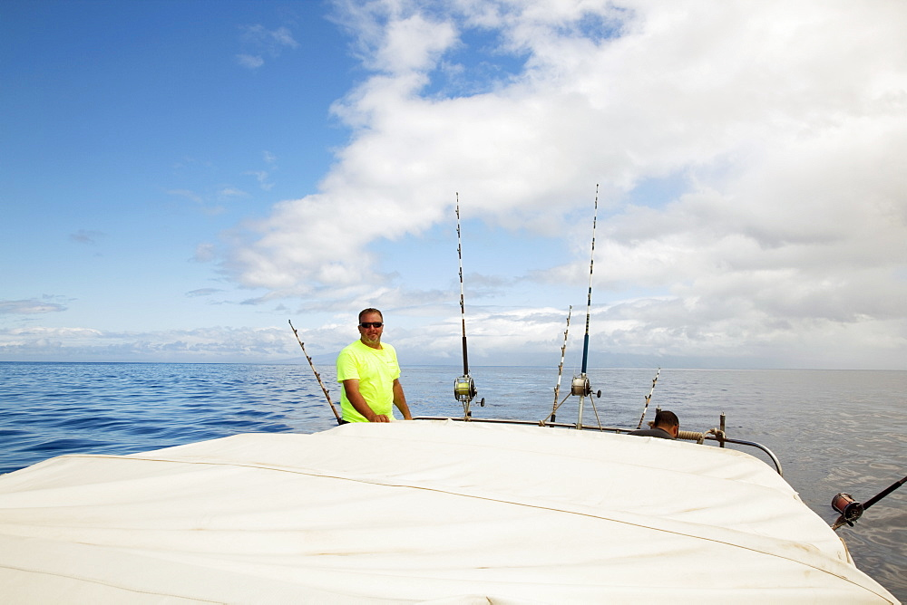 Hawaii, Maui, Man Poses With Poles On Fishing Boat