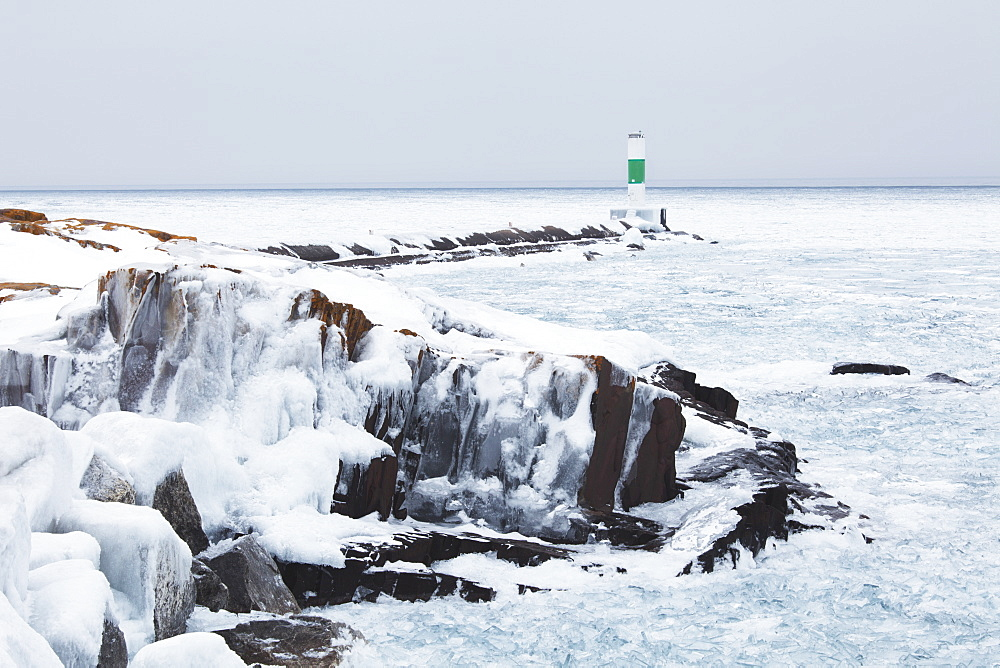 Ice On Lake Superior With A Lighthouse, Thunder Bay, Ontario, Canada