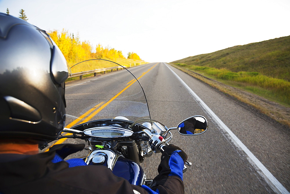 Motorcyclist Riding On The Highway, Near Edmonton, Alberta, Canada